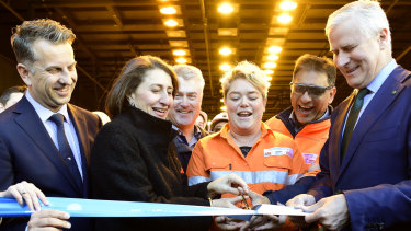 NSW Transport Minister Andrew Constance, left, Premier Gladys Berejiklian, training coordinator Marlee Mirabito and Deputy Prime Minister Michael McCormack cut the ribbon on Friday to officially open the new tunnels.
