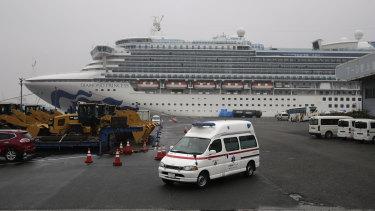 An ambulance leaves the port where the quarantined Diamond Princess cruise ship is docked.