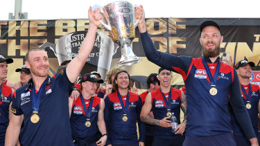 Wiiners: Coach Simon Goodwin and captain Max Gawn hold the premiership Cup aloft the day after their premiership win.