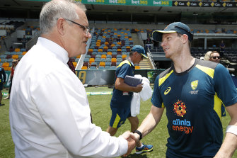 Prime Minister Scott Morrison greets Steve Smith at the Gabba.