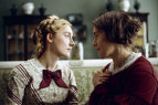 """Kate Winslet, right, and Saoirse Ronan in a scene from """"Ammonite."""""""