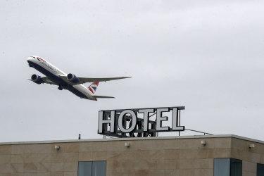 A plane passes over the Sofitel Hotel near London's Heathrow.
