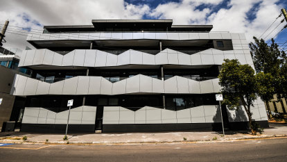 Cladding crisis leaves $5m apartment block in limbo for almost a year