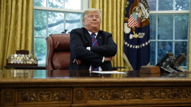 President Donald Trump crosses his arms after speaking with Mexican President Enrique Pena Nieto on the phone about a trade agreement.