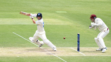 David Warner plays a shot during day two of the Sheffield Shield match between Queensland and New South Wales at The Gabba on Friday.