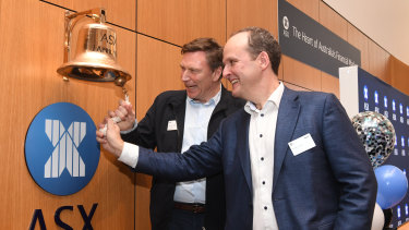 Tryo chairman David Thodey and chief executive Robbie Cooke ring the bell at the ASX on Friday in Sydney.