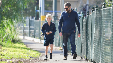 Grade three student Lachlan Hobbs with his father Tim Hobbs, returning to school at Albert Park Primary.