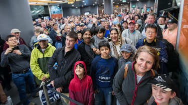 Hundreds of people line up at Chatswood to ride on the first driverless trains.
