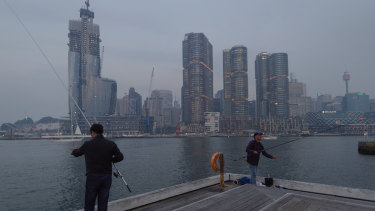 Smoke haze settles in Sydney Harbour.