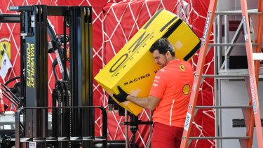 A Ferrari team member sets up for the grand prix.