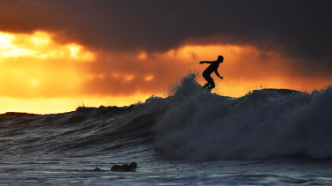 A surfer tackles the big waves at Bells Beach.