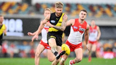 Attacking flair: Richmond's Nathan Broad puts boot to ball.