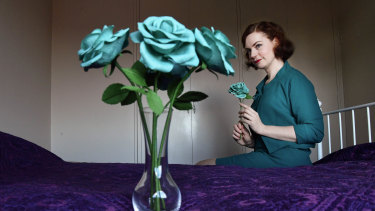 Hannah Poppins with some of her  handmade paper flowers, which she no longer describes as Tiffany blue.
