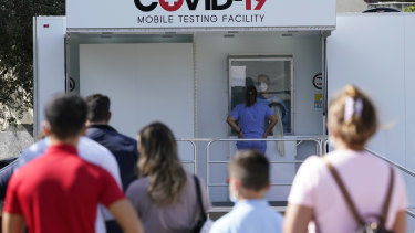 People lined up to receive a COVID-19 test in Opa-Locka, Florida.