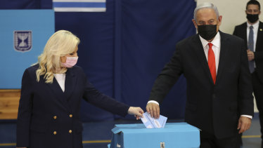 Israeli Prime Minister Benjamin Netanyahu and his wife Sara cast their ballots at a polling station in Jerusalem.