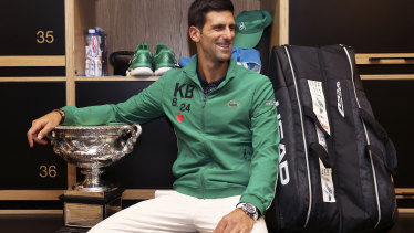 Djokovic with the Norman Brookes Cup in the locker room after his five-set victory over Dominic Thiem.
