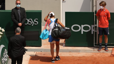 A dejected Ash Barty leaves the court after retiring hurt during her second-round match.