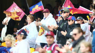Brisbane fans cheer after the Lions win against the Adelaide Crows at the Gabba on June 28.