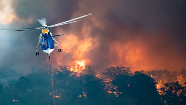 A firefighting helicopter tackling a bushfire near Bairnsdale in East Gippsland.
