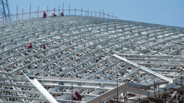 People work on the steel structure of the National Stadium, San Jose, Costa Rica.