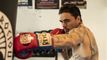 Sydney boxer George Kambosos jnr works the bag at his Sylvania gym. He's earned a shot at the undisputed lightweight crown and it could happen in Australia.