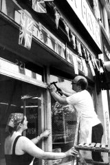 Worse to come … Terry and Maria Horsenell follow police warnings and cover their fish and chip shop window with netting where only last week they had put out bunting for the royal wedding.
