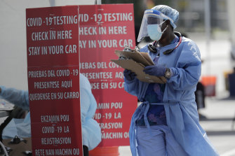 A healthcare worker at a COVID-19 testing site in South Florida, the centre of one of the latest outbreaks in the US.