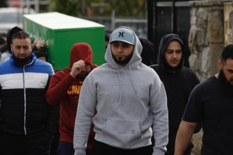 Bilal Hamze's brother Ibrahem, pictured in a grey hoodie and cap, was able to mourn with family after a successful court application.
