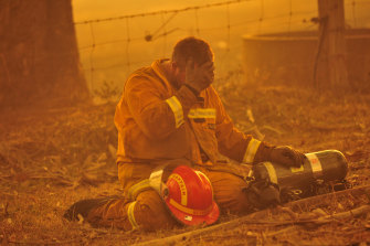 A firefighter in the midst of the blaze raging from Bunyip State Park on Black Saturday.