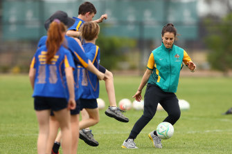 Selin Kuralay (right), capped 22 times for the Matildas, coaching primary school students in Shepparton in October.