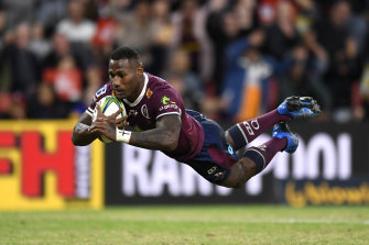 Suliasi Vunivalu scores a try during the round two Super Rugby Trans-Tasman match between the Reds and the Crusaders.