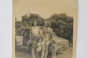Deborah, aged two, with her mother, father and sister, Bec (at right), on the Sunshine Coast in 1976.