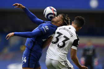 Reece James duels with Fulham's Antonee Robinson.
