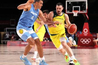 Australia's Chris Goulding drives to the basket against Luis Scola.