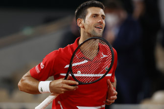 Novak Djokovic celebrates after his gruelling French Open semi-final victory over Stefanos Tsitsipas.