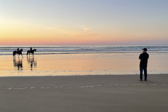 Terry Robinson cuts a lonely figure as  a frustrated watcher as Art Cadeau finishes his work at Seven Mile Beach.