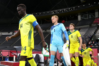Thomas Deng leads the Olyroos onto the field in Sapporo for their group game against Spain.