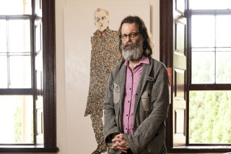 "The artist, who goes by the moniker ""What"", with his portrait of Robert Forster which won last year's Doug Moran Portrait Prize."