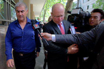 Bill Vlahos, left, outside court in 2016.