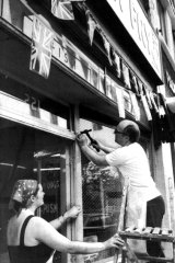 Worse to come … Terry and Maria Horsenell follow police warnings and cover their fish-and-chip shop window with netting where only last week they had put out bunting for the Royal wedding.
