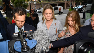 Australian swimmer Shayna Jack (centre) arriving for a briefing with ASADA in Brisbane.