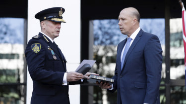 Home Affairs Minister Peter Dutton, right, swears in Australian Border Force commissioner Michael Outram  in May.