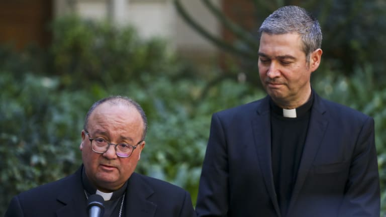 Archbishop Charles Scicluna, left, and Spanish Monsignor Jordi Bertomeuof, right, take part in a press conference at the Catholic University of Chile, in Santiago, Chile.