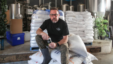 David McGrath from Illawarra Brewing Company with some bags of grain which will be sent to farmers after they are cooked.