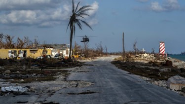 A helicopter flies over the village of High Rock, Grand Bahama, after delivering emergency supplies.