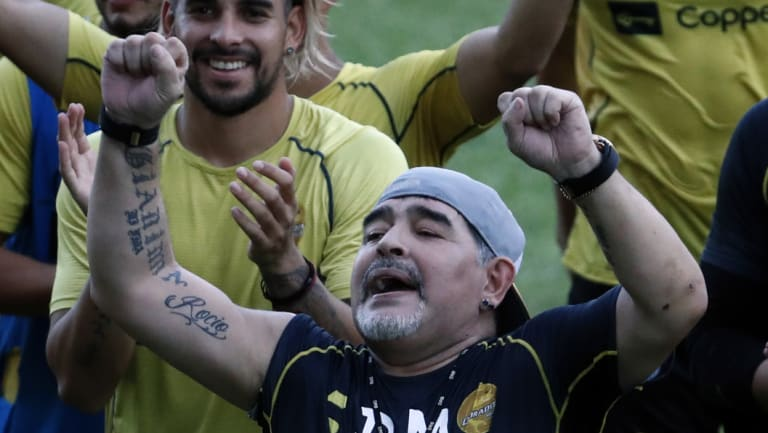 Rejoice: Diego Maradona sings with his team and fans during a training session with his new club Dorados.