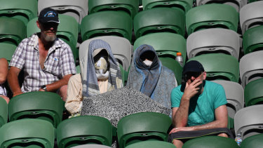 The fans in the stands are sometimes just as brave as the players during the heat.