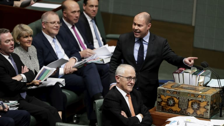 Then Environment and Energy Minister Josh Frydenberg addresses Parliament, with then PM Malcolm Turnbull and Coalition frontbenchers listening in.