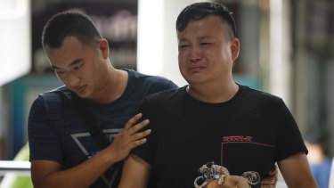 A relative of a victim in the boat sinking being consoled at the Vachira Phuket Hospital.