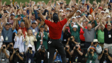 The roar of the crowd resounded around Augusta as Woods' win hit home.
